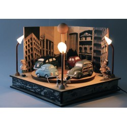 Collectible music box with 4 cars with one boy and one girl with lights