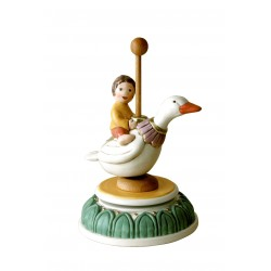 Children music box with a little baby girl riding a duck, a wonderful article made compleatly by ceramic, hand made and hand dec