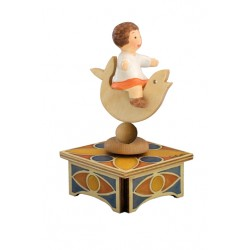 Children music box with a little baby girl riding a fish, a wonderful gift for babies or children.