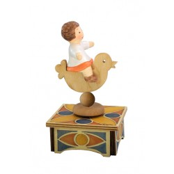 Children music box with a little baby girl riding a bird, a wonderful article made of wood and ceramic.