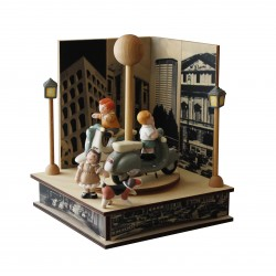 Collectible music box with 2 motorbikes with 2 boys and one girl.