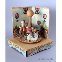Children & Bike carousel music box, a wonderful article made of wood and ceramic.