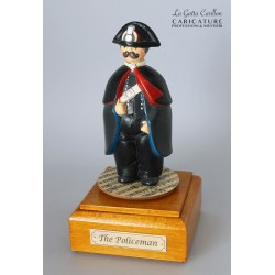Customize caricature of a POLICEMAN, musical box version or the simple statue version.