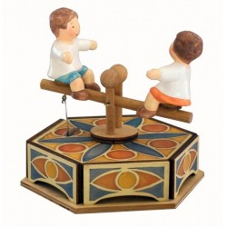 Carousel music box with two little babies. Gift for children, for Christmas, birthday or baby shower.